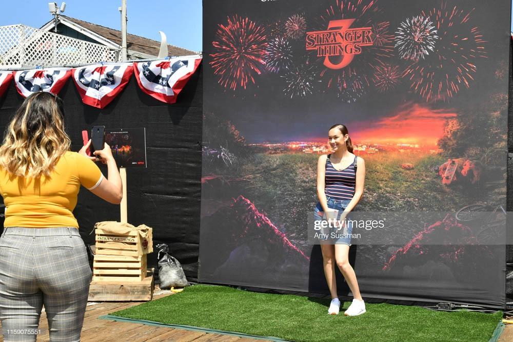 "SANTA MONICA, CALIFORNIA - JUNE 29: Fans pose at the many photo-op stations at the Netflix's ""Stranger Things"" Season 3 Fun Fair at Santa Monica Pier on June 29, 2019 in Santa Monica, California. (Photo by Amy Sussman/Getty Images)"