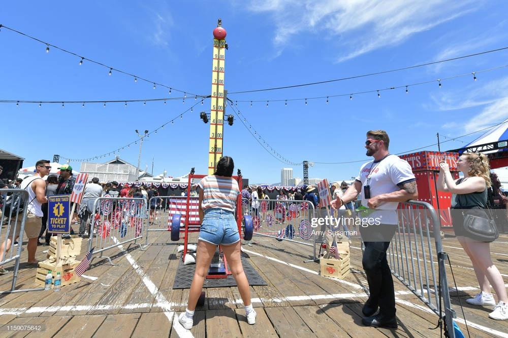 "SANTA MONICA, CALIFORNIA - JUNE 29: Fans participate in the many games at Netflix's ""Stranger Things"" Season 3 Fun Fair at Santa Monica Pier on June 29, 2019 in Santa Monica, California. (Photo by Amy Sussman/Getty Images)"